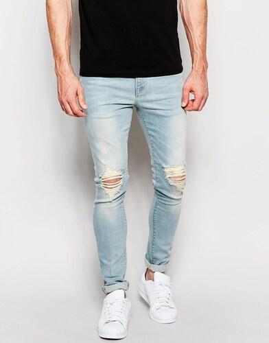 f066e86fe6f ASOS DESIGN Голубые выбеленные супероблегающие джинсы с рваными коленками  ASOS - Синий